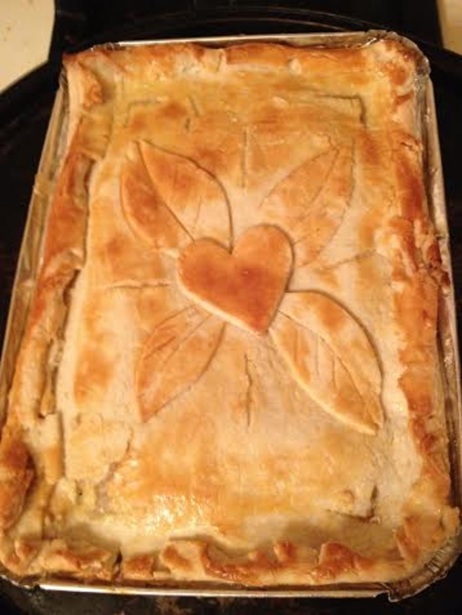 Homemade chicken pot pie made with healthy ingredients and enclosed in a home made pie crust.