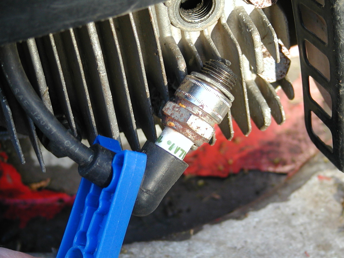 Hold the spark plug against the cylinder head and pull the starter cord to check for a spark. You may need an assistant. A plastic clothes peg may be a good idea to prevent shock in case the lead is damp!