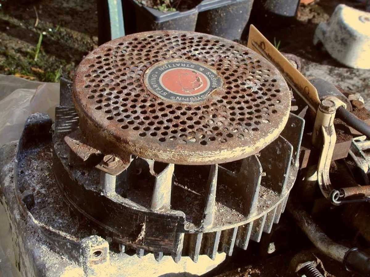 Engine flywheel, visible when the cowling or cover over the mower is removed.