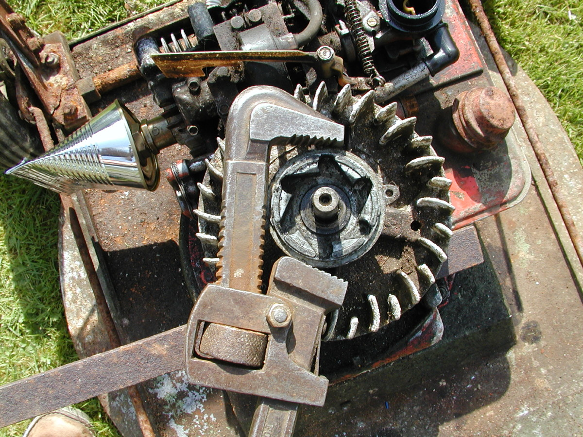 Use a pipe wrench (Stillson) to remove this piece. Keep the jaws away from the screw lugs to avoid damaging them.