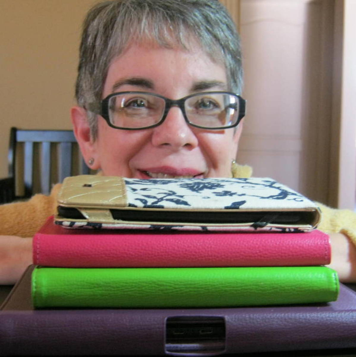 The author with her stack of Kindle readers and Fire tablets.