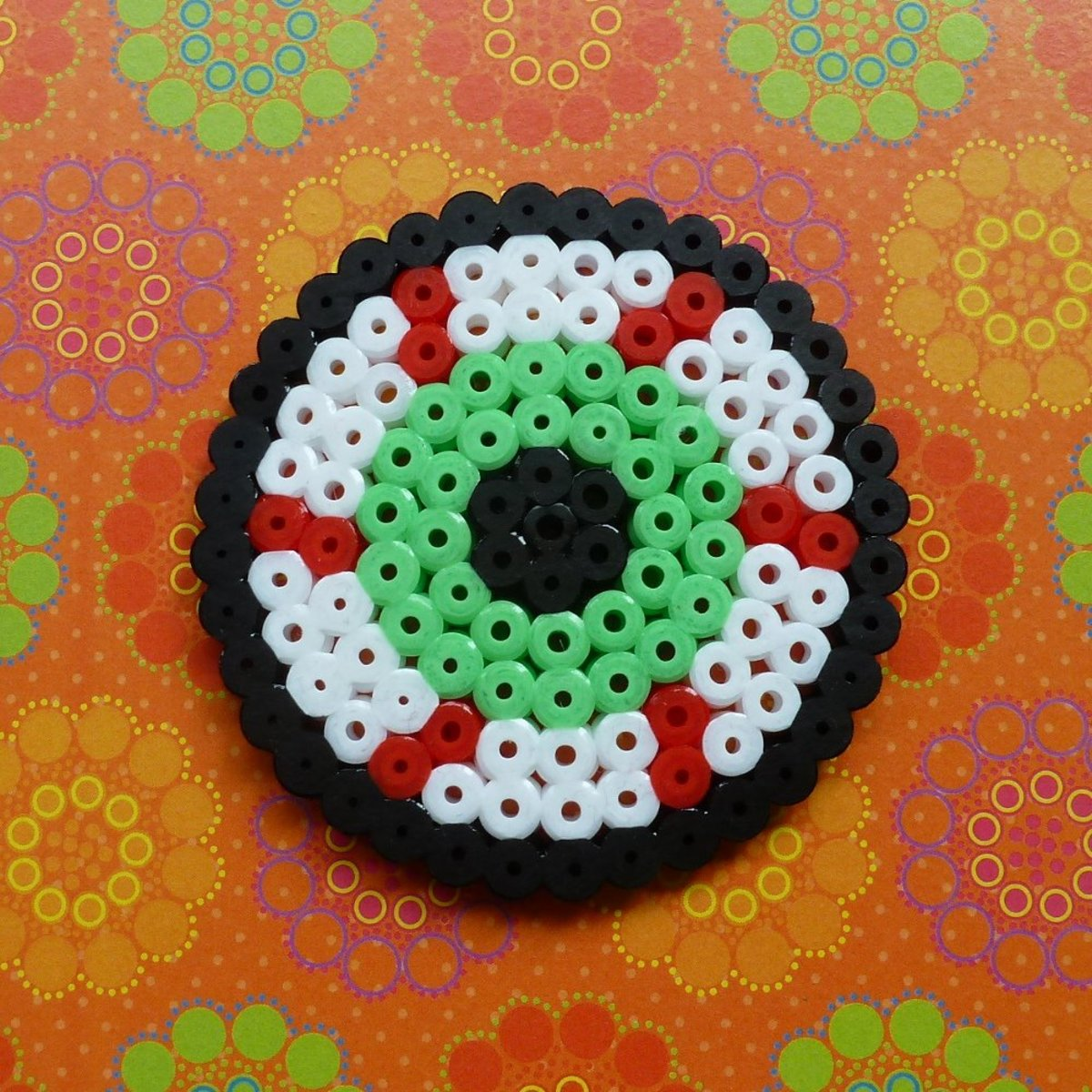 Perler beads are the perfect crafting tool for spooky Halloween art projects.