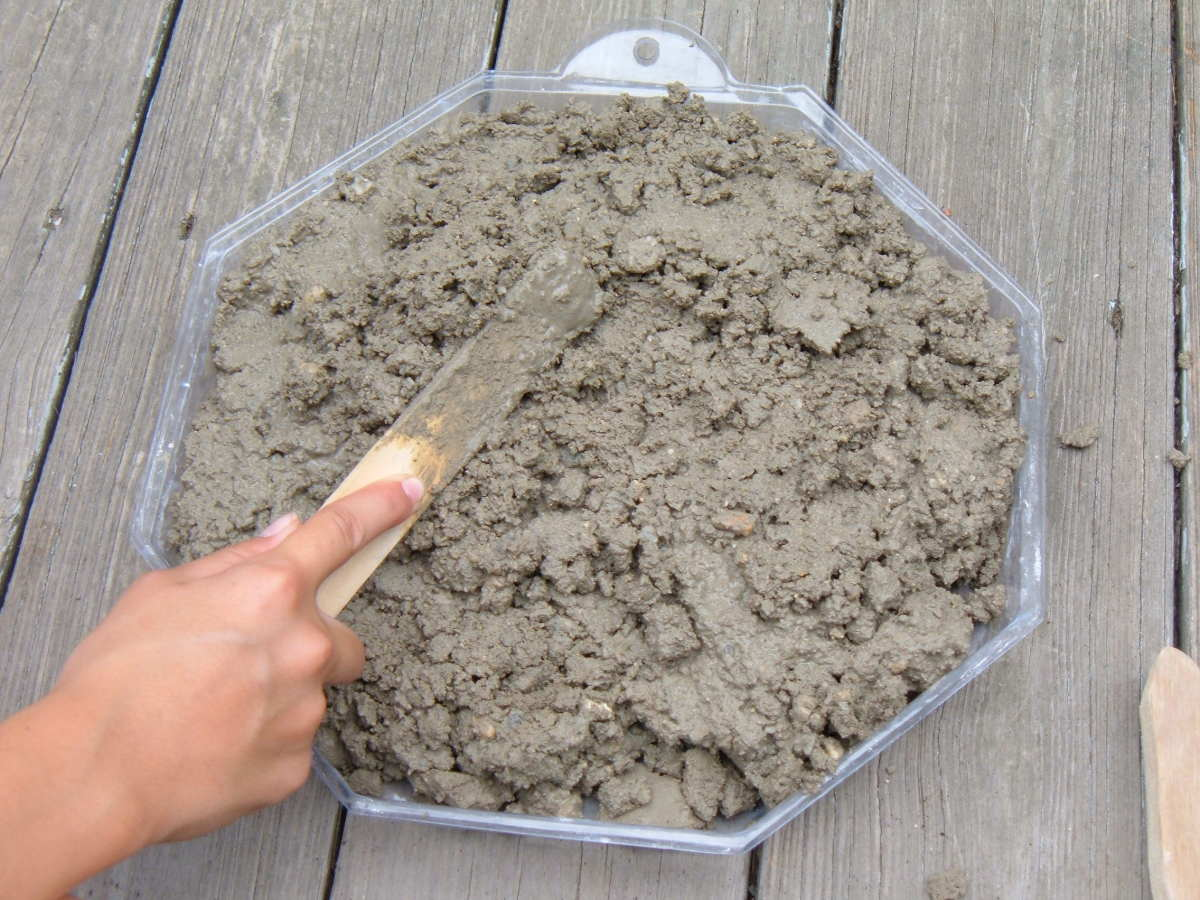 Fill the stepping stone mold with concrete