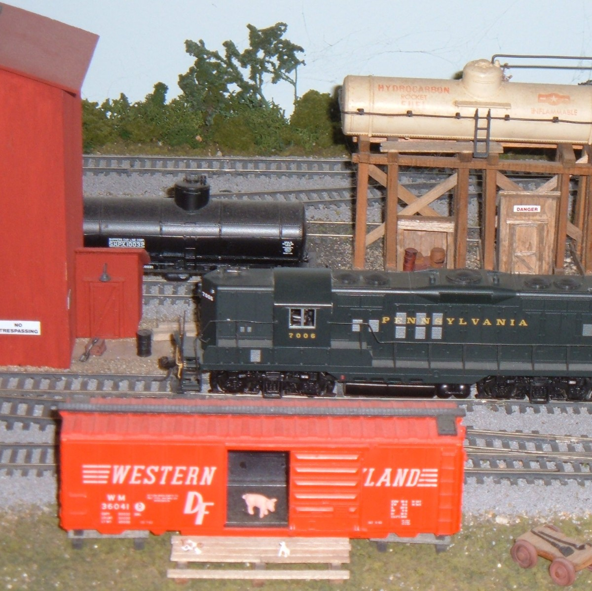 Pennsy #7006 leads a local freight past a small yard on my HO model railroad
