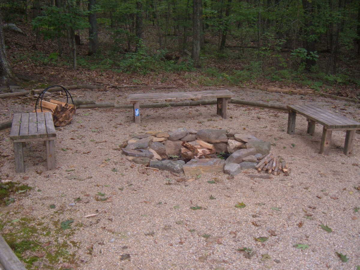 Fire pit surrounded by pea stone