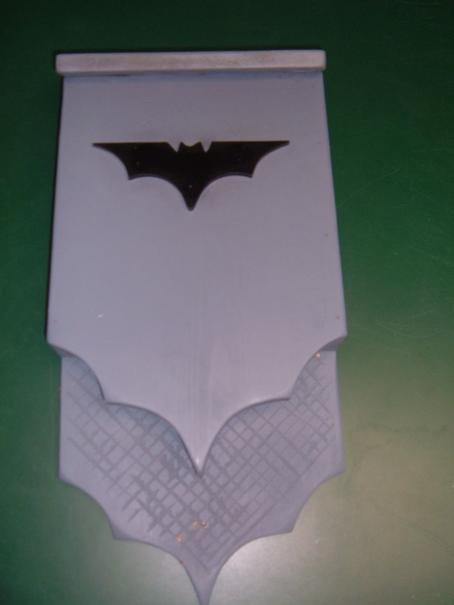 My custom-made bat box has scalloped wing edges and a familiar bat emblem