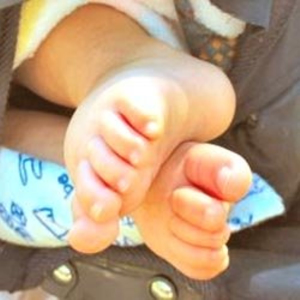 Feet of a baby in a car-seat