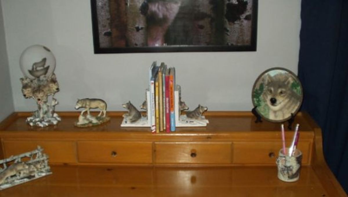 We bought this cool desk at a used furniture store, and added wolf bookends, figurines, and other accessories that we found at various places.