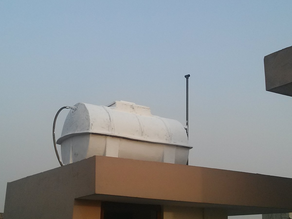 water tank painted with calcium carbonate