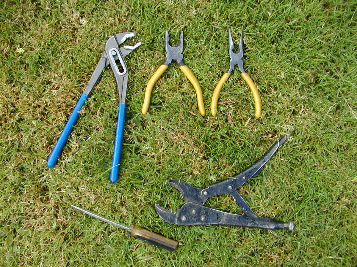 Clockwise from top - Water pump pliers, standard jaw pliers, long nose (snipe) pliers, curved jaw vise grips, flat blade screwdriver
