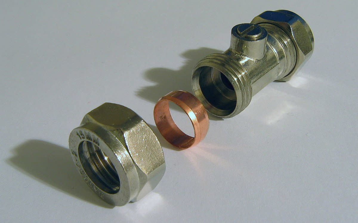 "Inline Isolating valve, often used for disconnecting water to individual appliances. One end of the fitting has the nut removed showing the compression ring or ferrule (also known as an ""olive"") which seals and makes the fitting water tight."