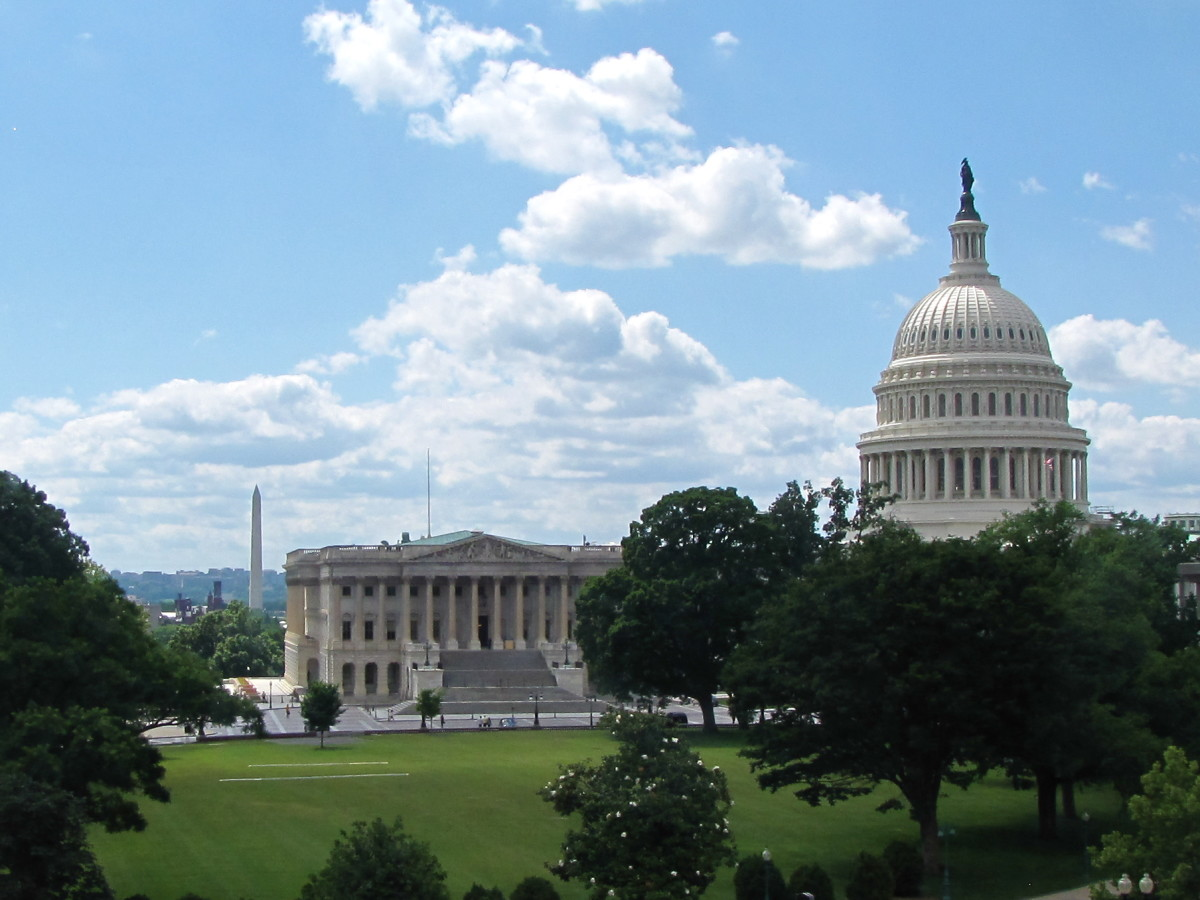 The US Capitol with the Washington Monument behind it.