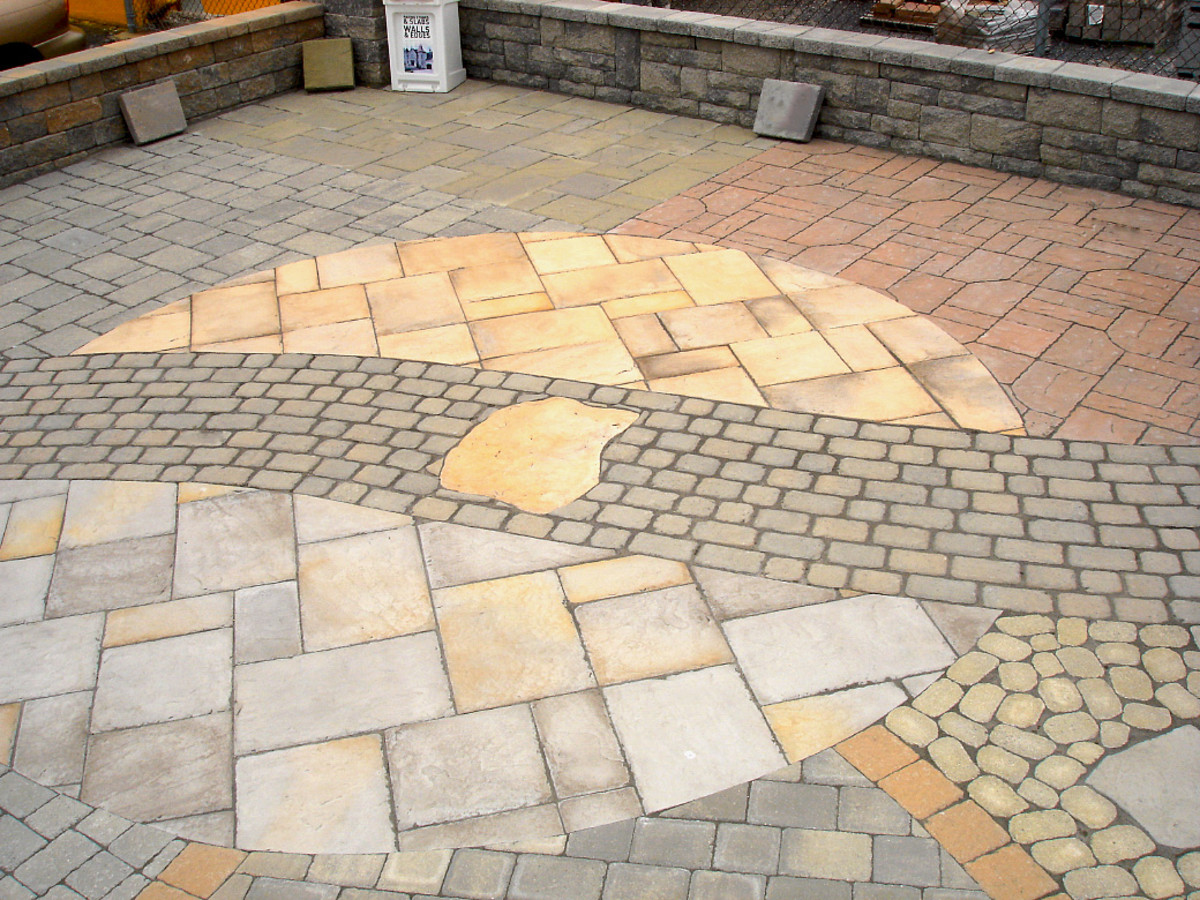 Polymeric sand between a medley of paver shapes and sizes.