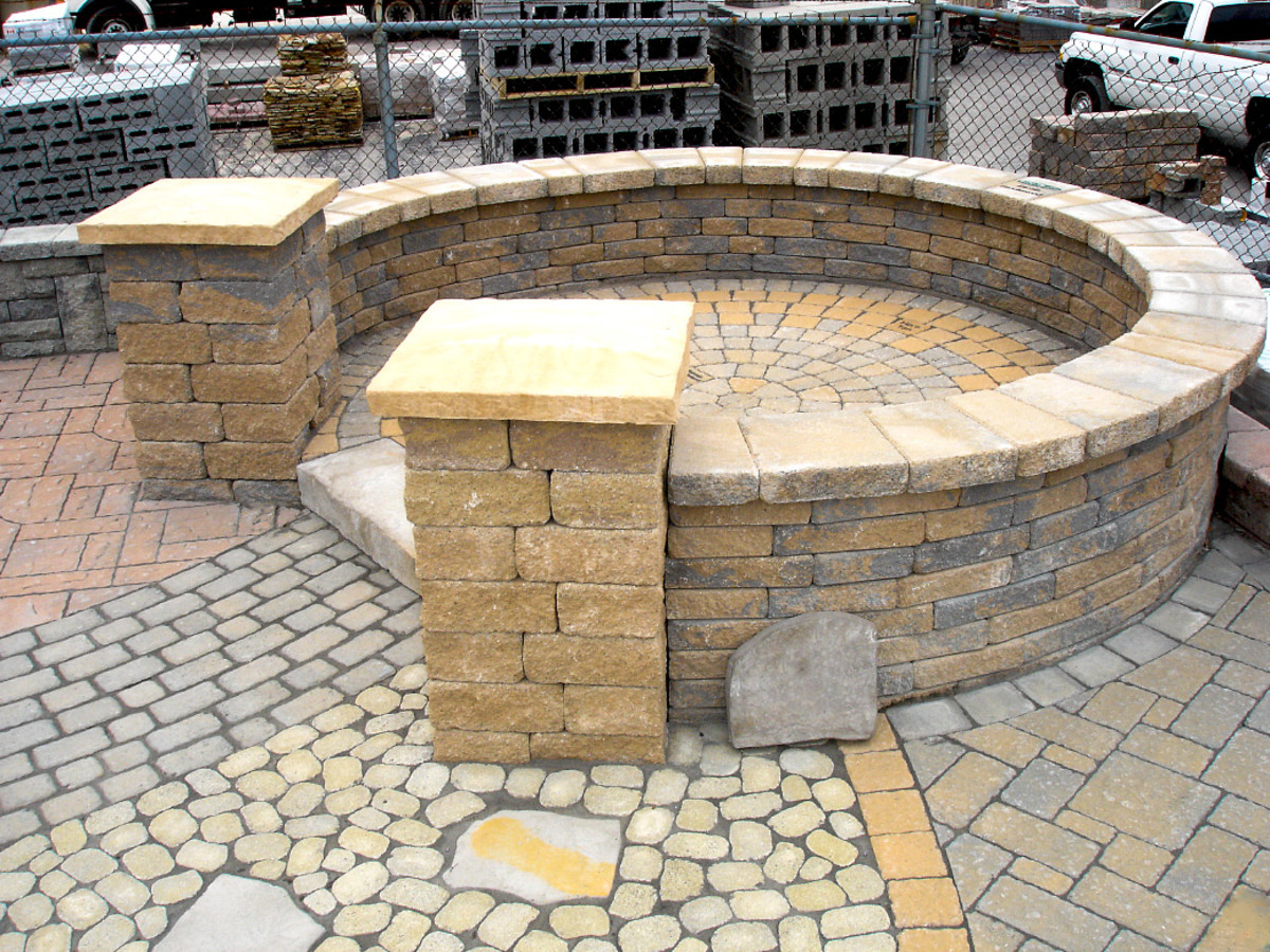 More pavers interlocked with polymeric sand including a circle pattern patio.
