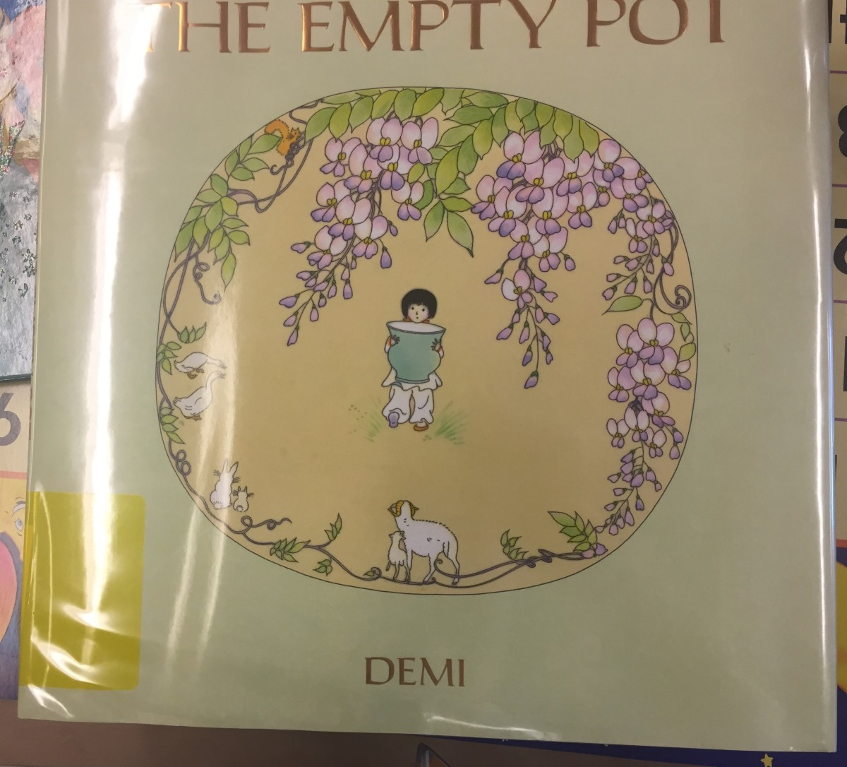 Old wisteria vines are common in China and Japan. On the cover of this book about a Chinese boy who is gifted with a talent for gardening, wisteria is showcased.