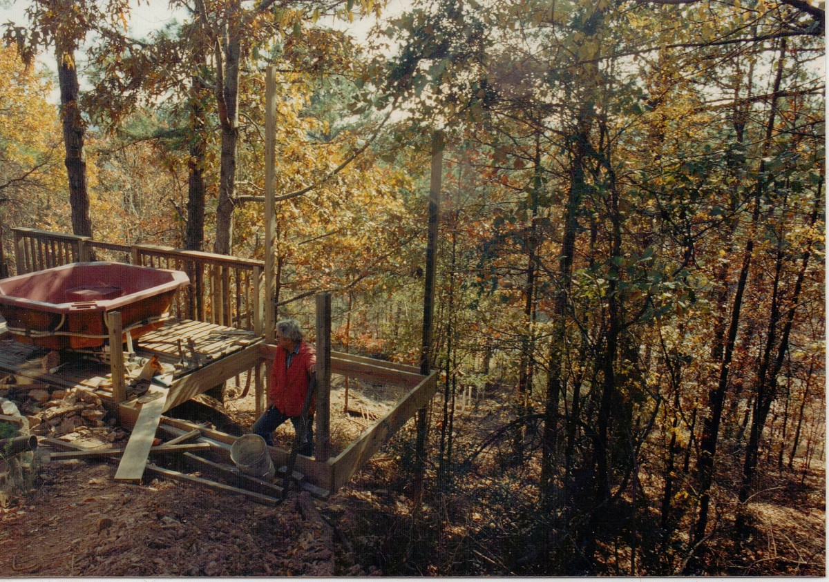 My husband building the third deck with hot tub