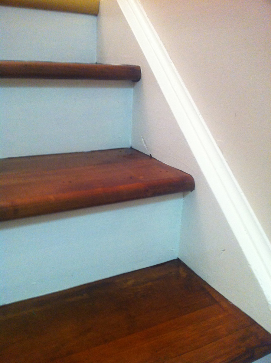 Stairs with a rustic-look stained tread and white painted risers