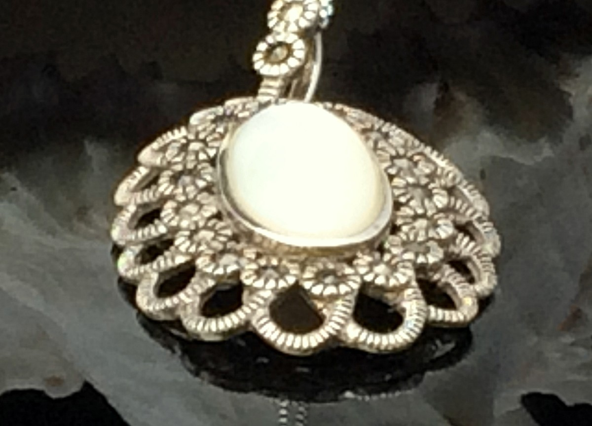 Circa 1920's sterling silver Chinese Export pendant set with mother of pearl and marcasites.