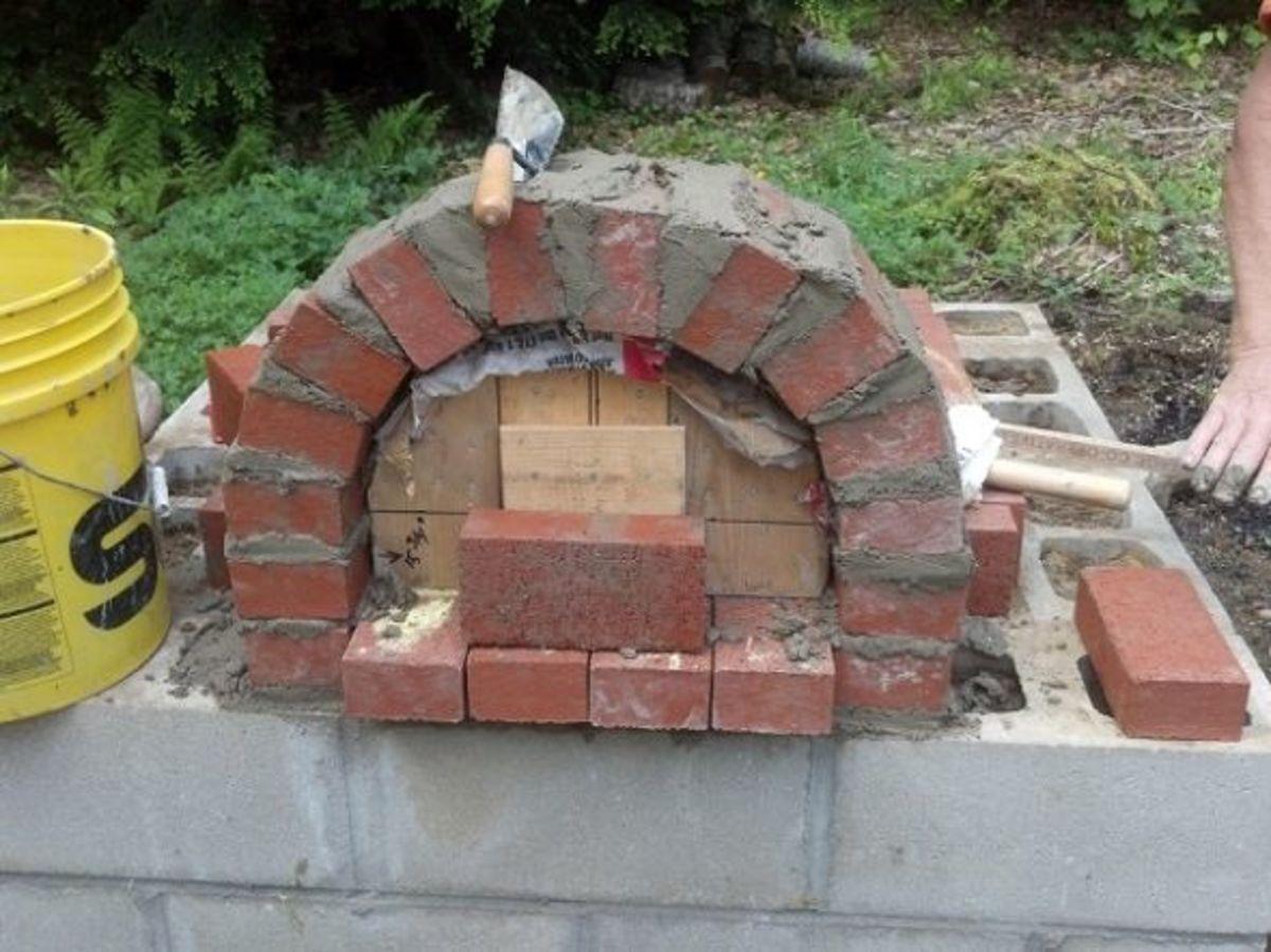 Brick entrance arch construction