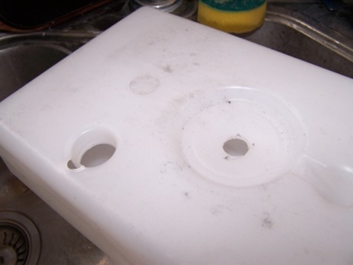 Flip it upside down so the holes are inverted and empty the chamber