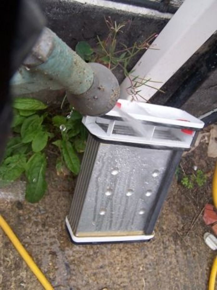 I prefer to clean mine outside because it's easier. Run water through all sides of the unit until no more lint comes out