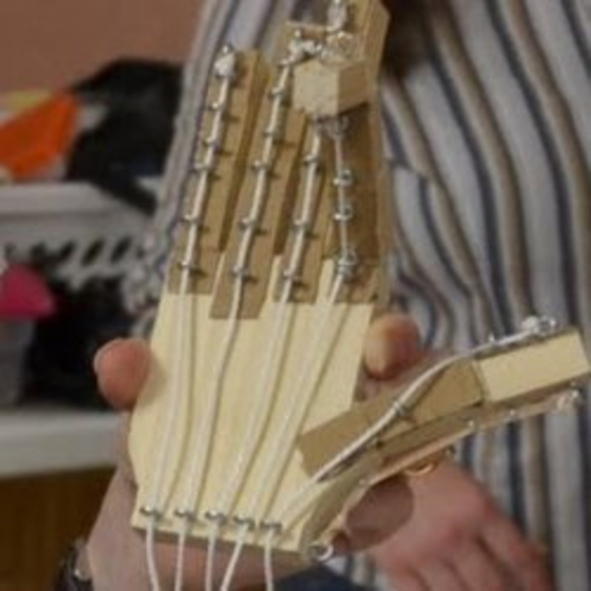 Working wooden model of the bones of the hand and tendons