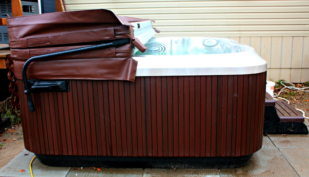 Side view of my jacuzzi J-365 hot tub with roasted chestnut cabinetry and opal shell.