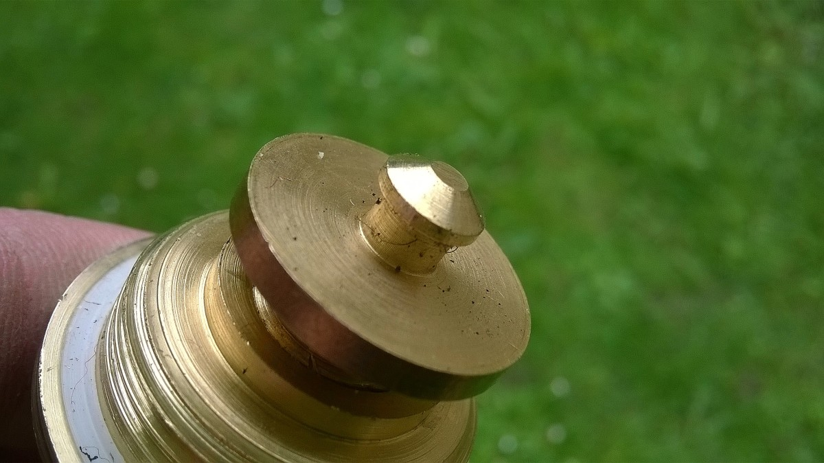 """This flanged piece is called a """"jumper"""" and has a mushroom shaped lug (or nut) at the center to retain the washer"""