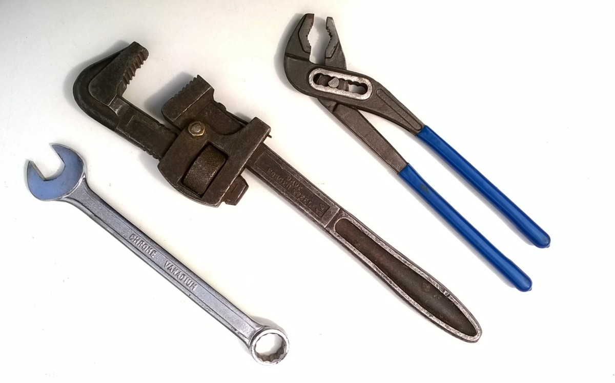 From left to right - Wrench (spanner), Stilsons (pipe wrench), water pump pliers. Either of these can be used to remove the head of the tap
