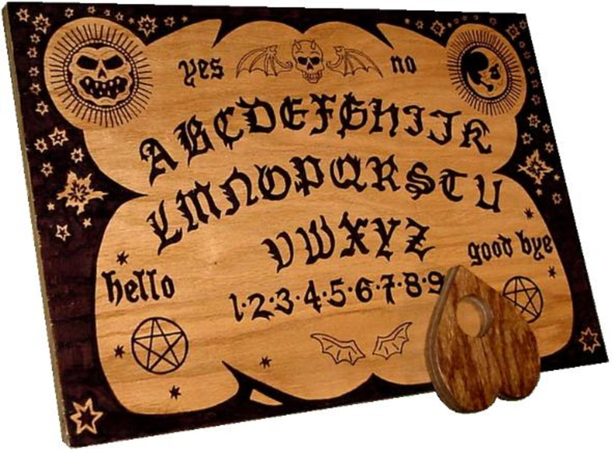 How to make a homemade Ouija board. You can use cardboard or wood as a base.