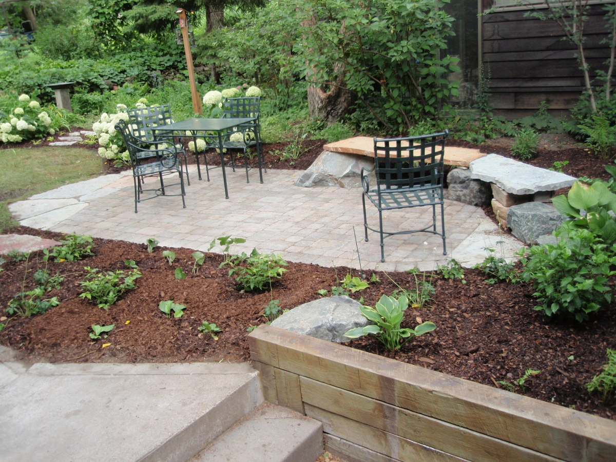 Grey pavers surrounded by mulch