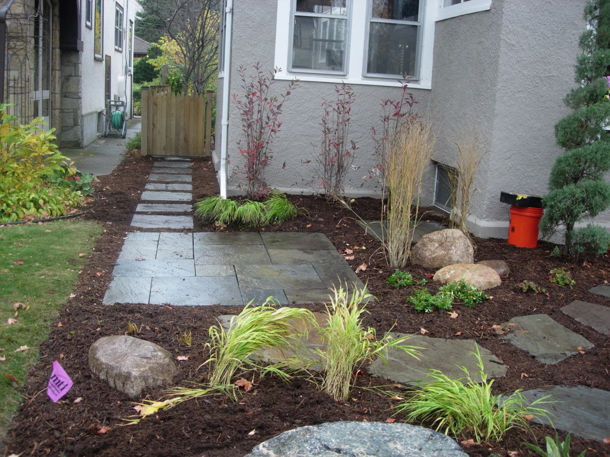 Square patio tiles as a path and seat area