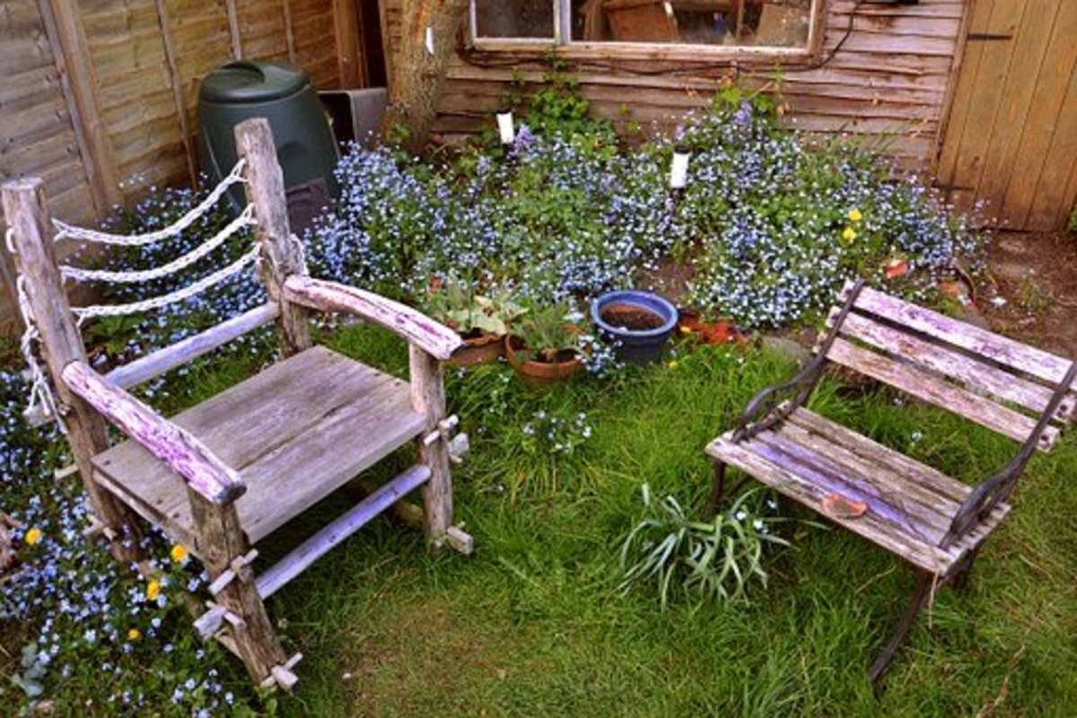 Rustic wood chairs on the grass