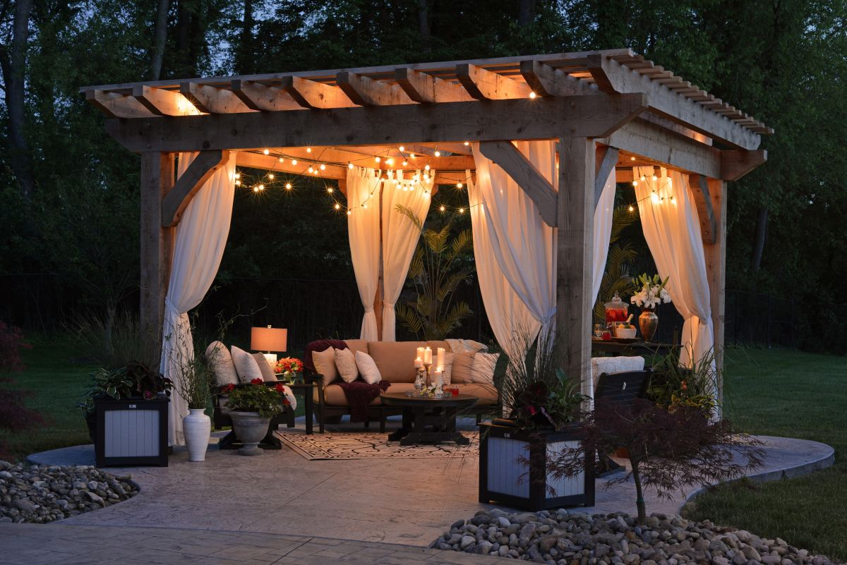 Romantic getaway in your own backyard.  A pergola with flowing drapery