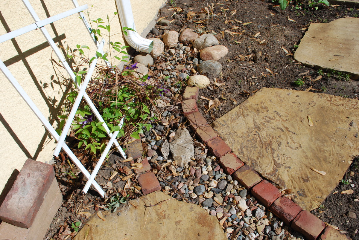 Edging combining rocks and pavers