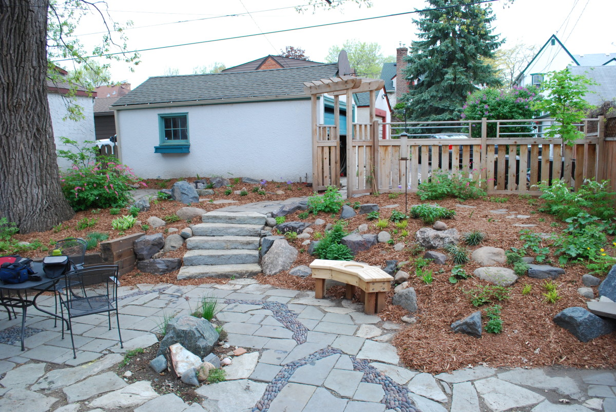 Mulch, rocks and stairs.