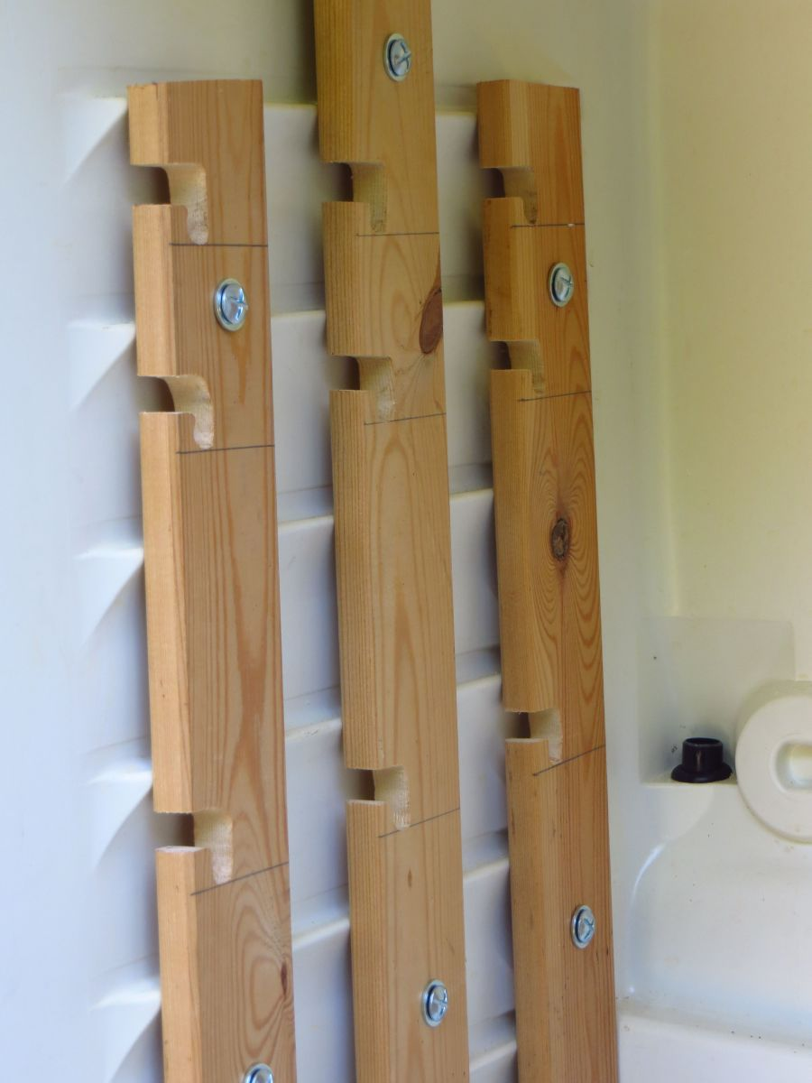 Measuring and arranging your slats properly ensures that your rods will hang straight and level.
