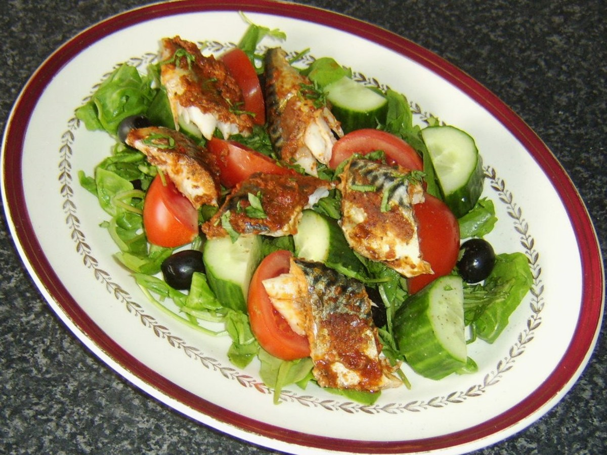 Mackerel in red pesto sauce with salad