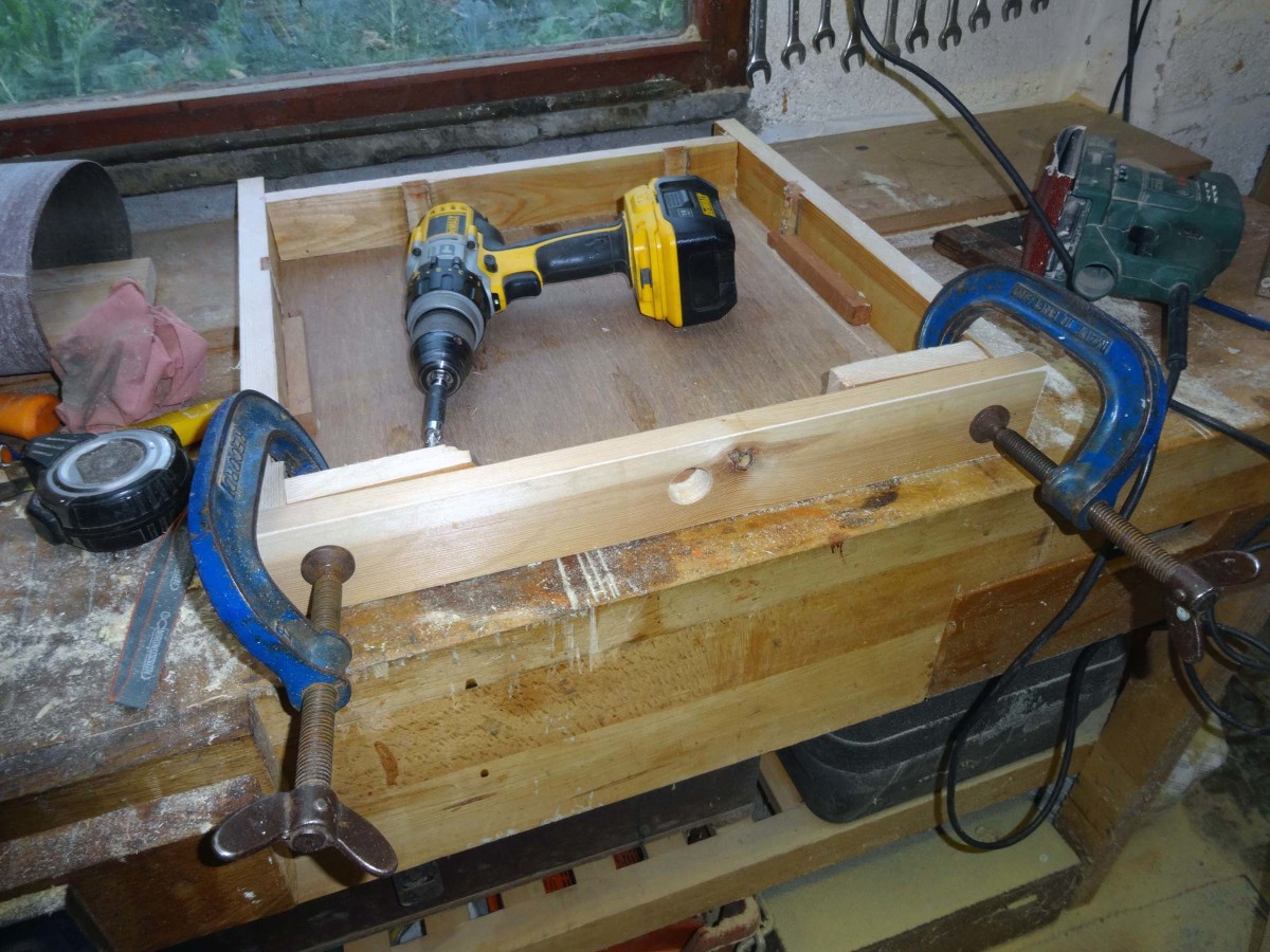 Constructing the plinth drawer with pull hole centred in the front.