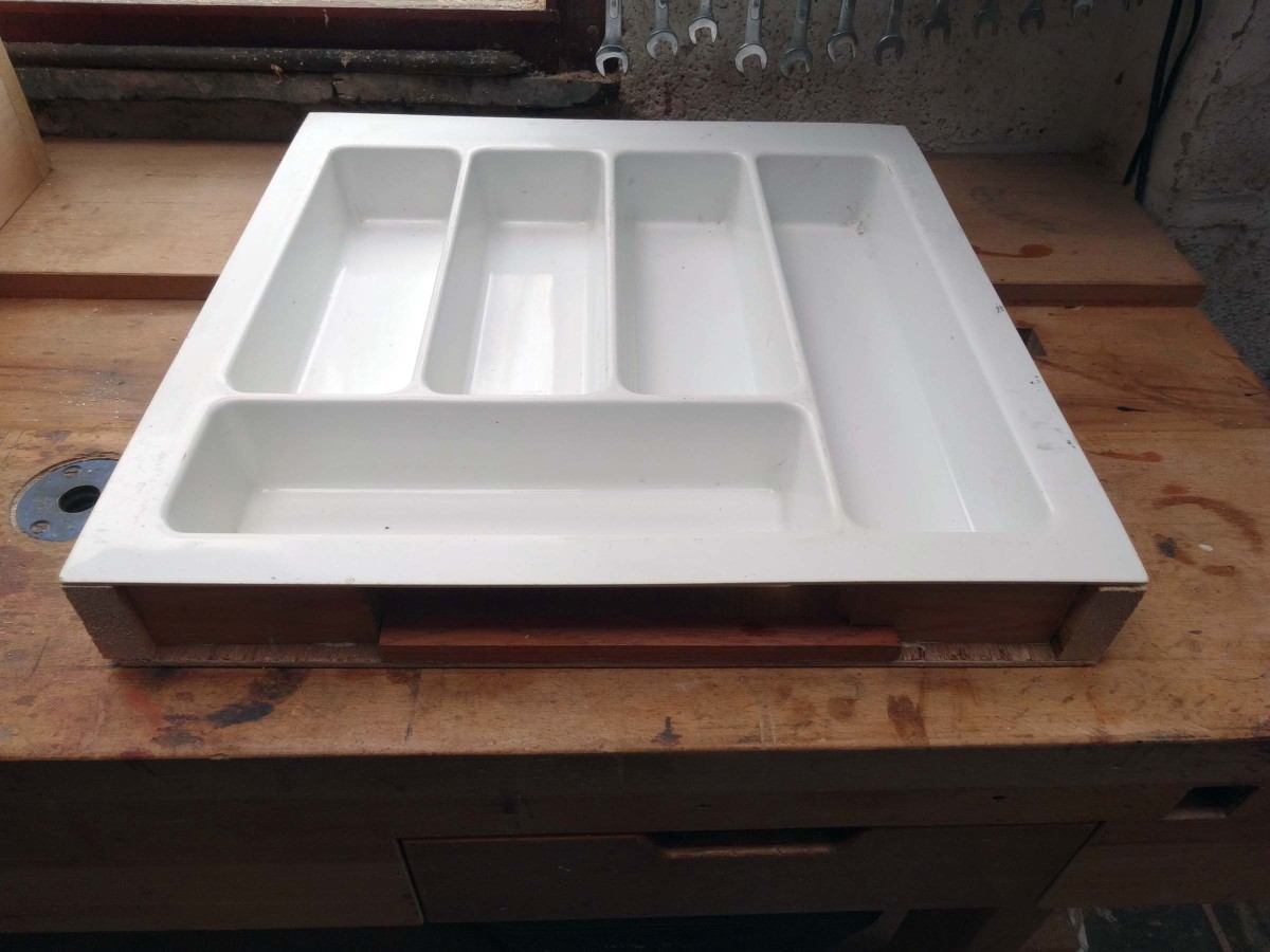 Test fit of the cutlery tray into the bespoke plinth drawer