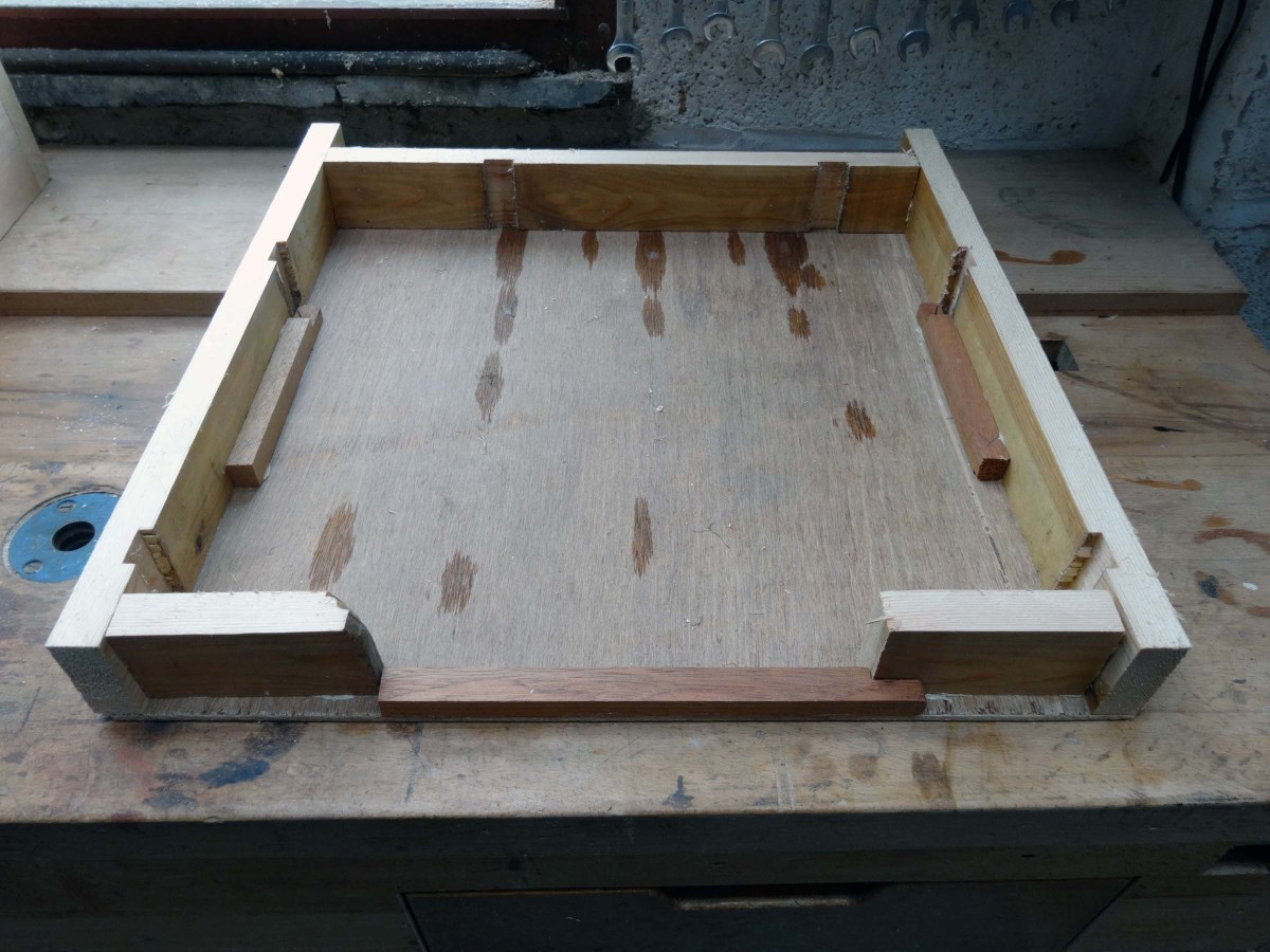 Constructing a box to precisely fit the cutlery tray, leaving space at the front for a pull hole.