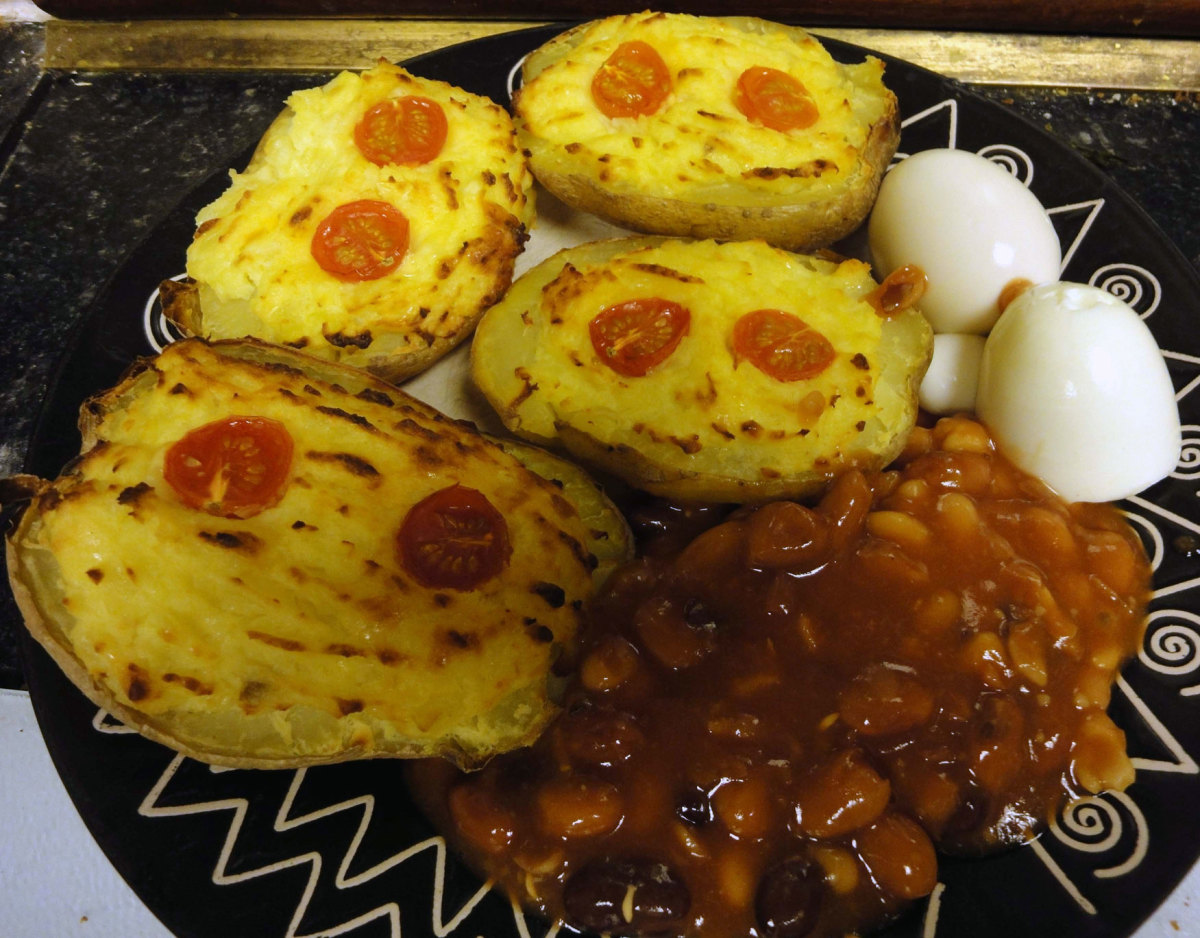 Stuffed Baked Potatoes With Cheesy Potato Sauce