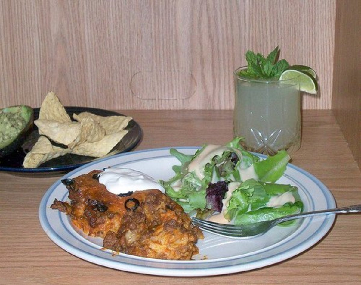 Enchilada Casserole with Mojito, Salad, and Chips