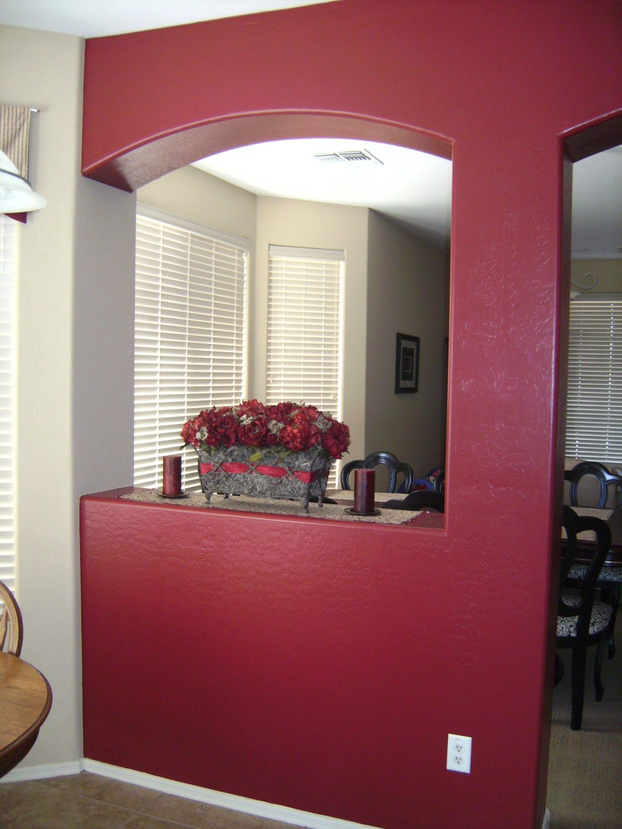I painted this red accent wall between my formal dining room and kitchen area to create a visual division between the two areas.