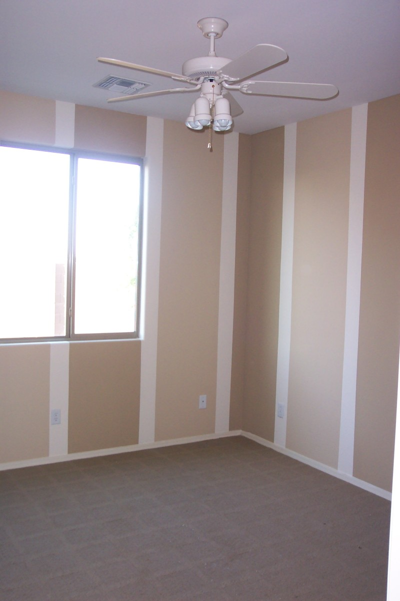 This is our guest room before any furniture was moved in.  The vertical stripes add height to a small room, and the neutral colors leave room for various types of decor.