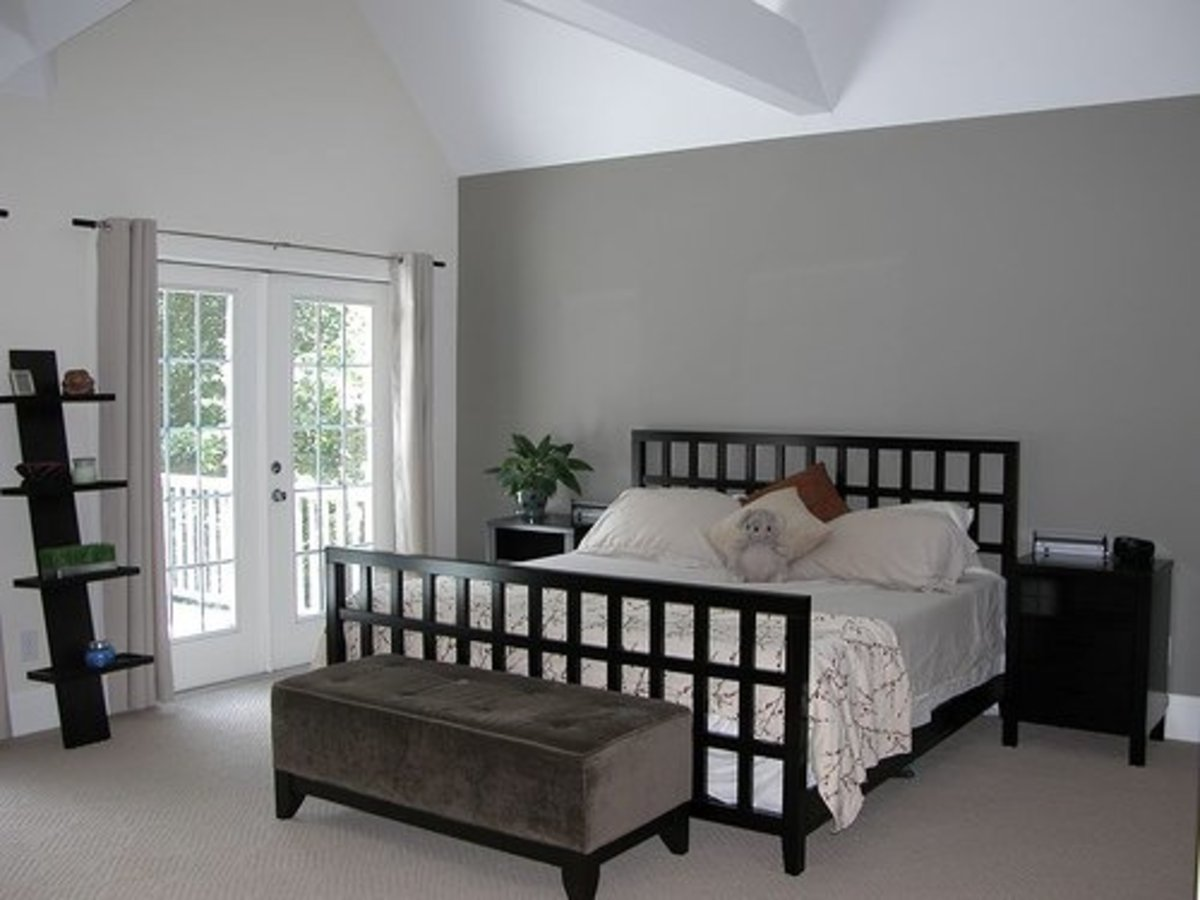 I love the gray accent wall in this master bedroom.  Photo is courtesy of http://www.flickr.com/photos/christinel