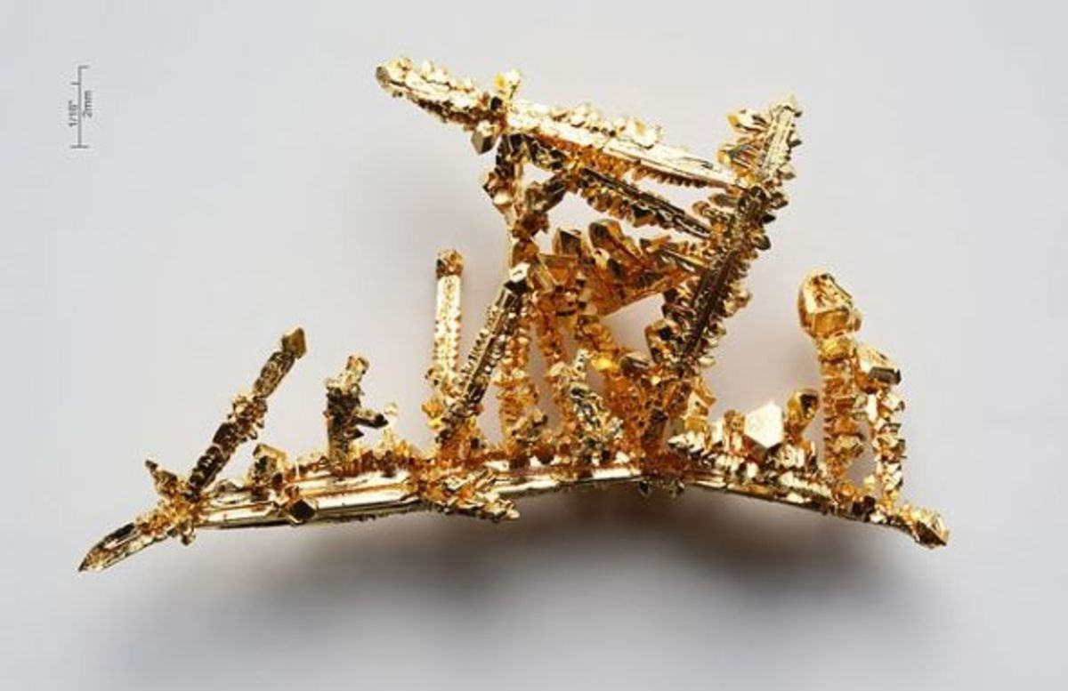 Synthetic gold crystals created by the chemical transport reaction in chlorine gas—purity > 99.99%