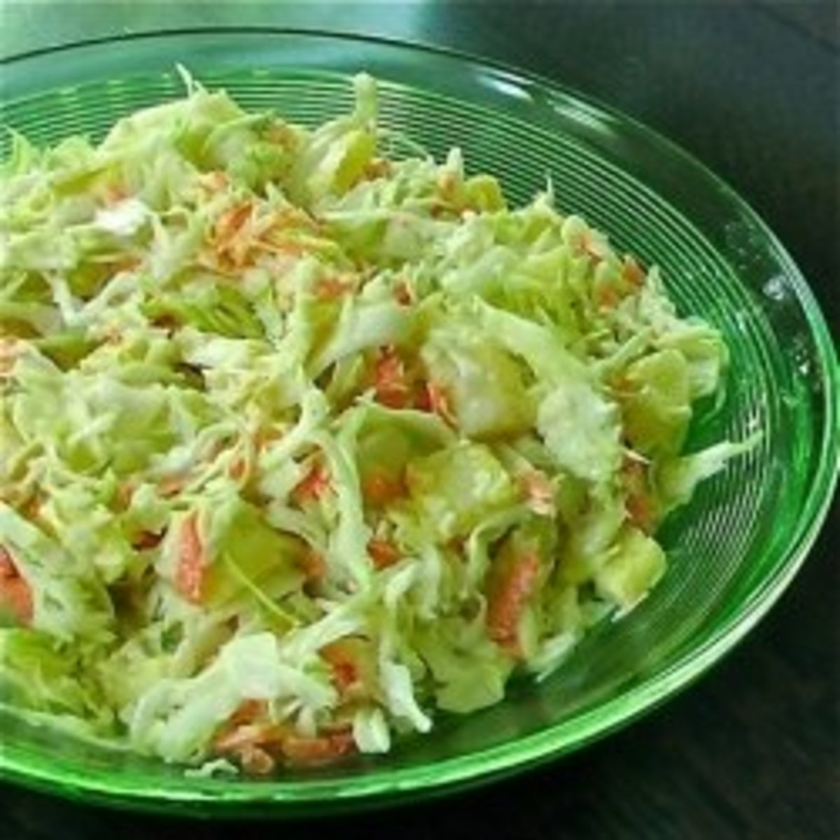 My mom's coleslaw recipe as made by me. The carrots and pineapple tidbits make this recipe delicious.