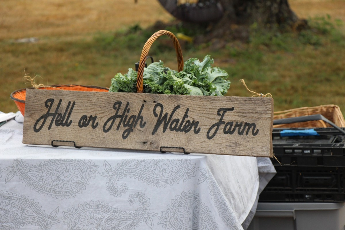 This sign is portable so the farm owners can take it to farmer's markets. Quite a creative name for their home.