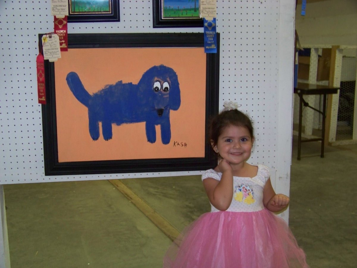 "For her ""Blue Dog Art"" Painting, 2 year old, Kash, placed 2nd in the Tiny Tots Division. Kash sees her ribbon for the her blue dog painting! This is her first large sized acrylic painting."